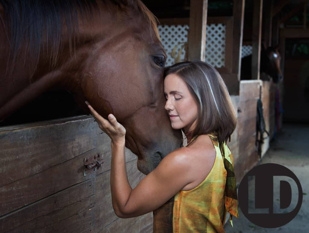 Karen Stollmeyer-Matthews at the stables of Horses for Healing.