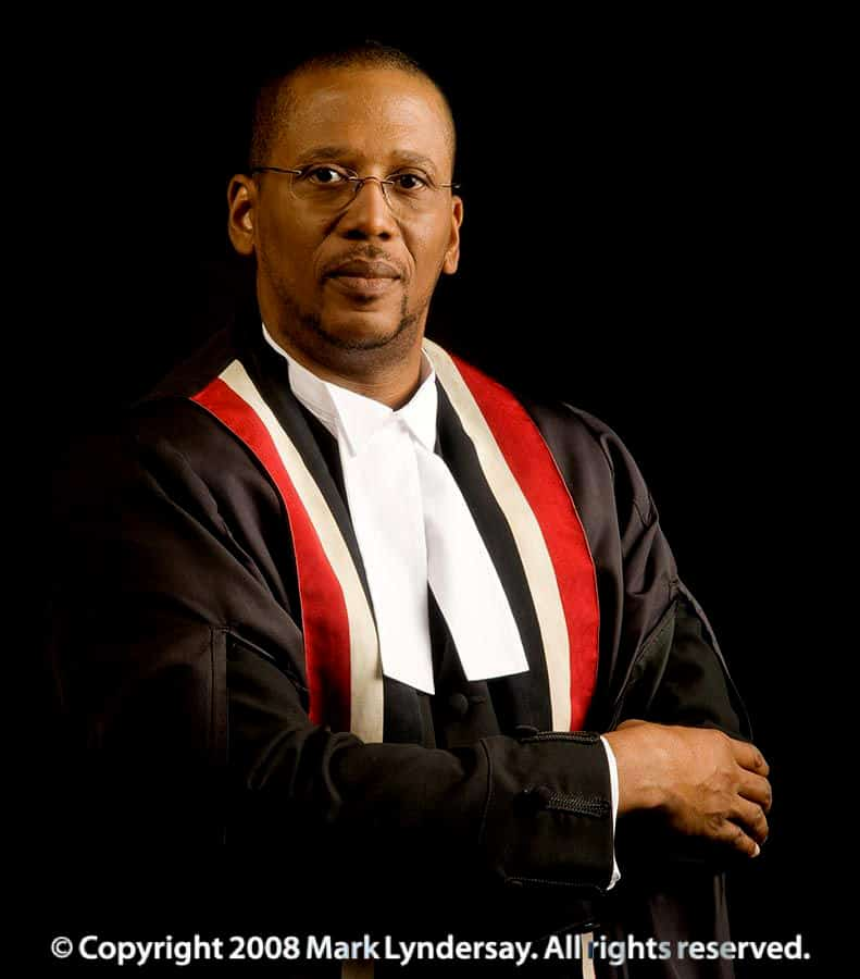 Chief Justice Ivor Archie photographed in a built studio at his office