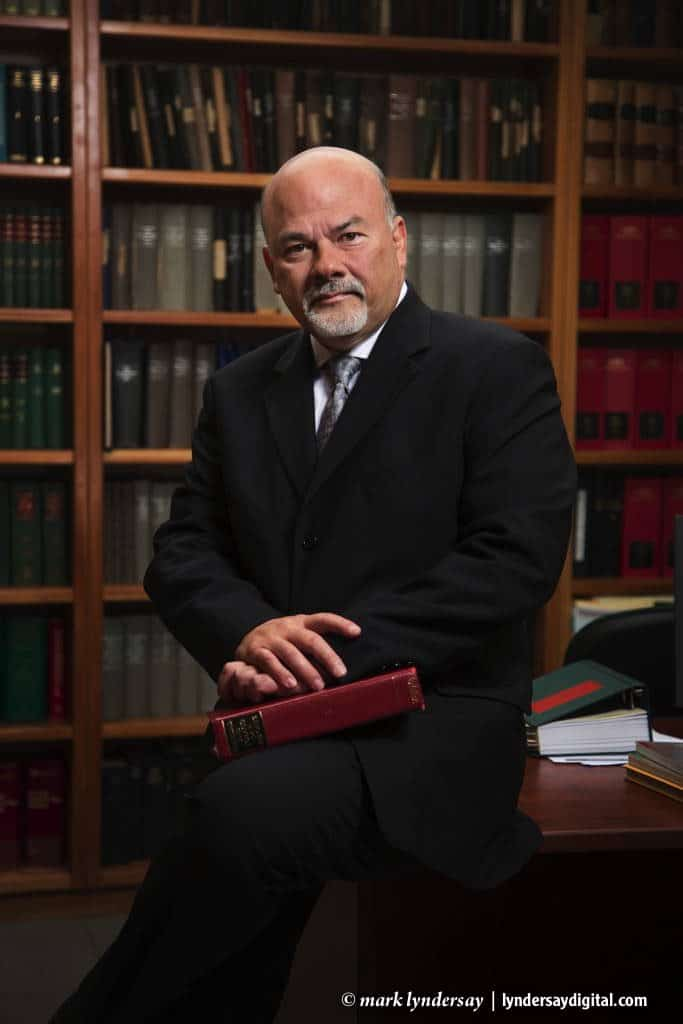 Mark Morgan in his company's legal library